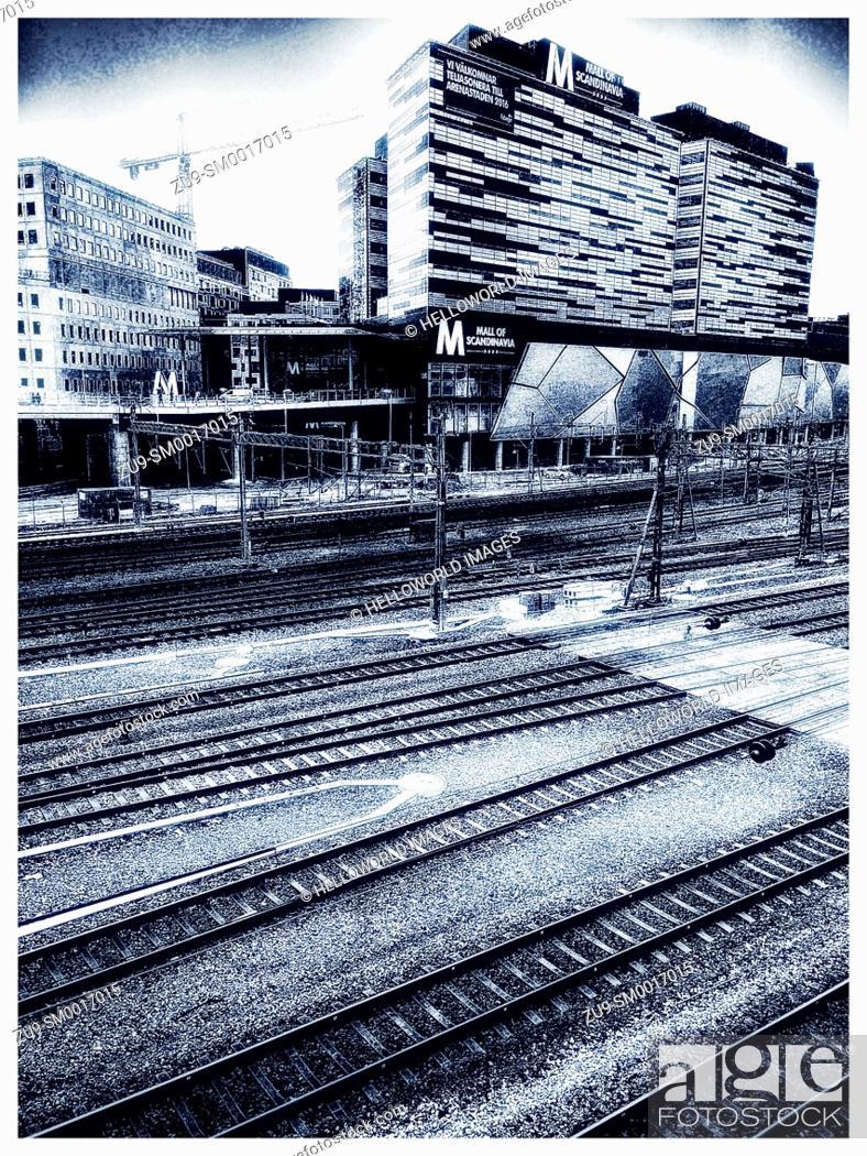 Photo de stock: Multiple railway lines passing the Mall of Scandinavia shopping centre, Solna, Stockholm, Sweden, Scandinavia.