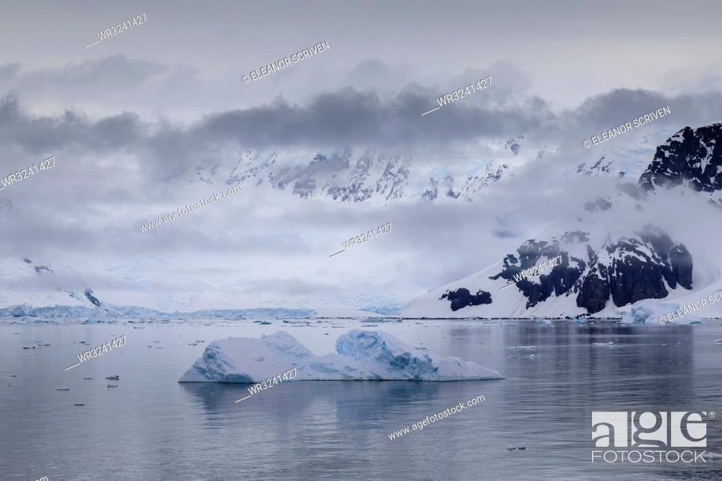Stock Photo: Low lying mist and clouds over mountains, glaciers and icebergs of Paradise Bay, calm waters, Antarctic Peninsula, Antarctica, Polar Regions.
