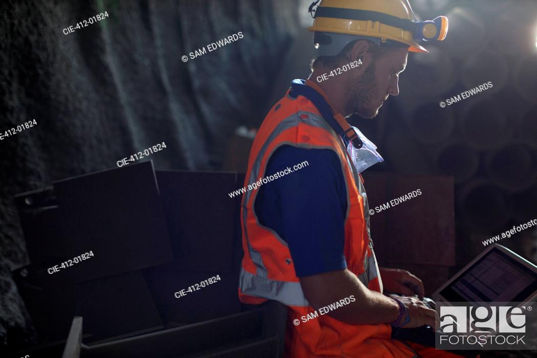 Stock Photo: Worker using laptop in tunnel.