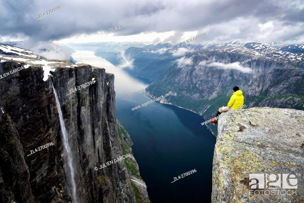 Stock Photo: Norway, Rogaland, Lysefjord, Kjerag (Kiragg), hiker watching the fjord 1000m below.