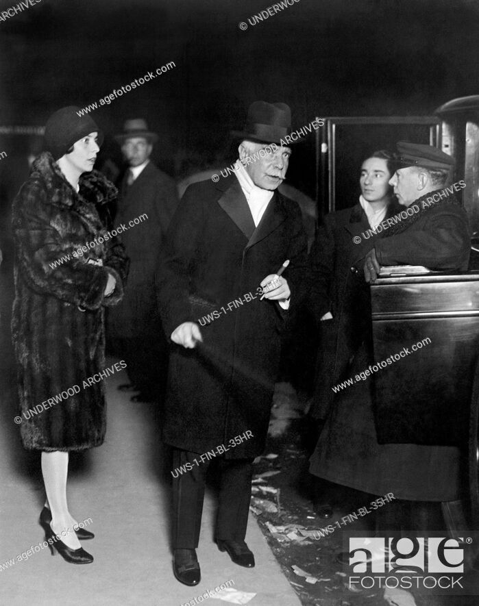 Stock Photo: New York, New York: c. 1929 Financier and banker Otto Kahn arrives with his daughter to attend the six day bicycle races being held at Madison Square Garden.