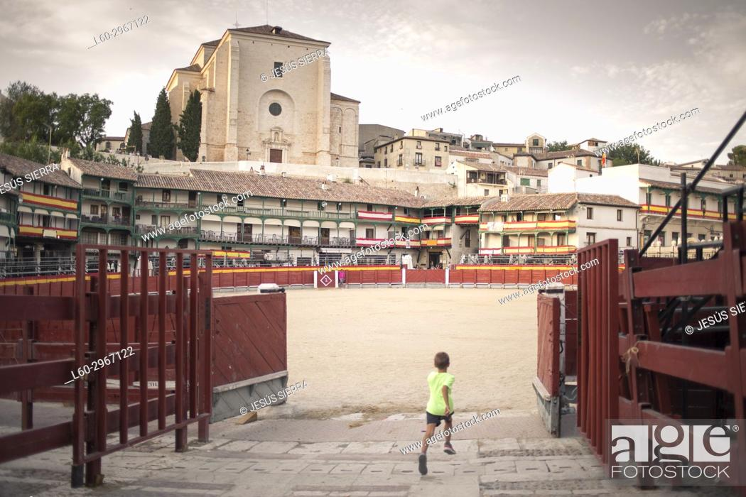 Stock Photo: Boy running in Chinchón, Madrid province, Spain.