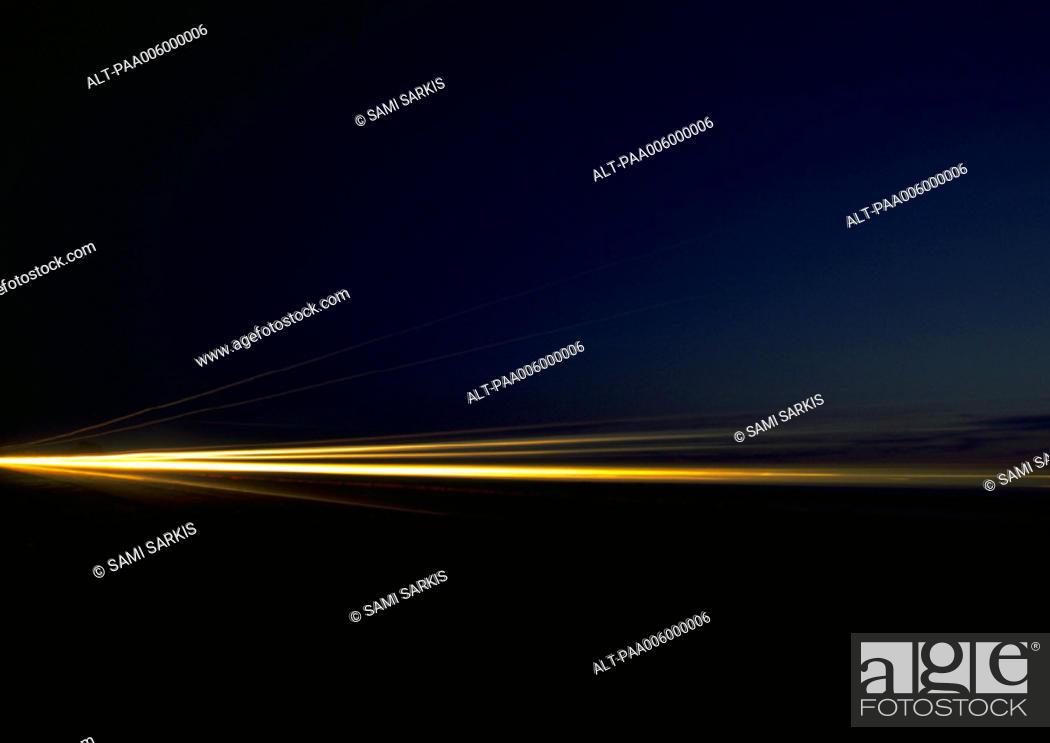 Stock Photo: Light trails at night, blurry.