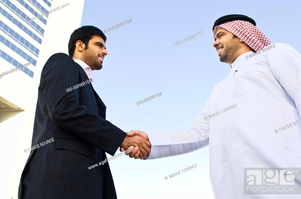 Stock Photo: Businessmen shaking hands.
