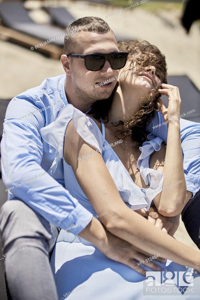 Stock Photo: man embracing woman, on sunbeds, holidays, love, affair, sensual, couple, flirt, summer.