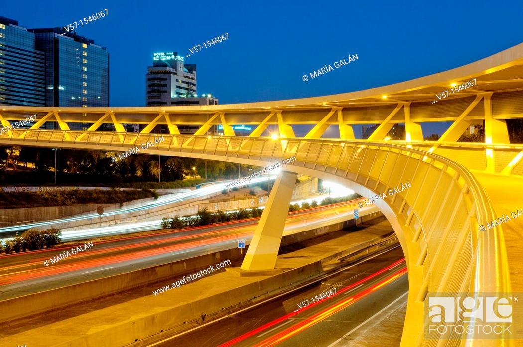 Stock Photo: La Paloma bridge and M-30 motorway, night view. Madrid, Spain.