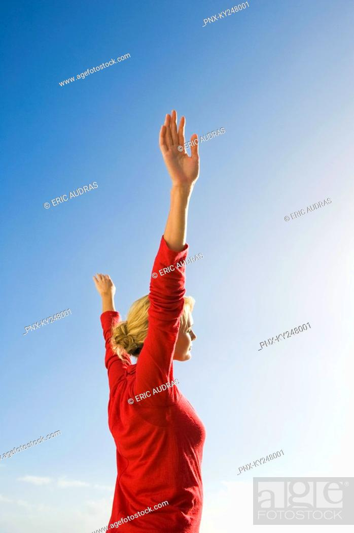 Stock Photo: Woman stretching her arms.