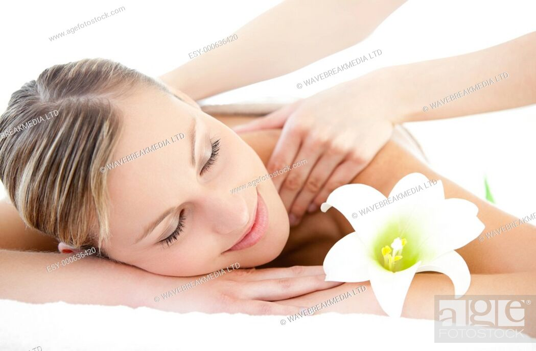 Stock Photo: Relaxed woman receiving a back massage in a Spa center.