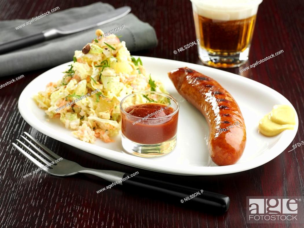 Stock Photo: Sausage with salad, ketchup and mustard.
