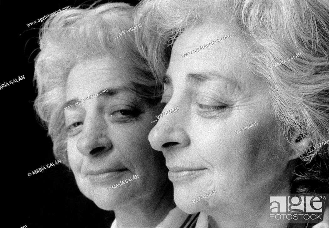 Stock Photo: Mature woman's face Mirrored image. Black and White.