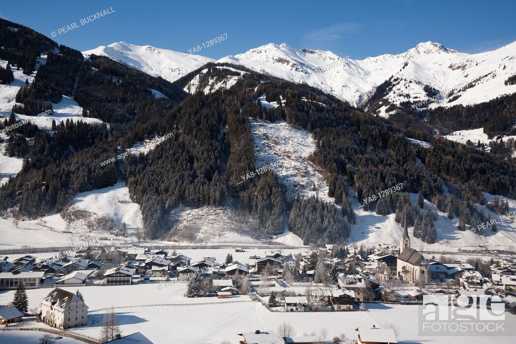 Stock Photo: Rauris Austria / January Alpine ski resort village in Austrian Alps with snow in Rauriser Sonnen Valley and on Sonniblick Mountains in winter in Nationalpark.