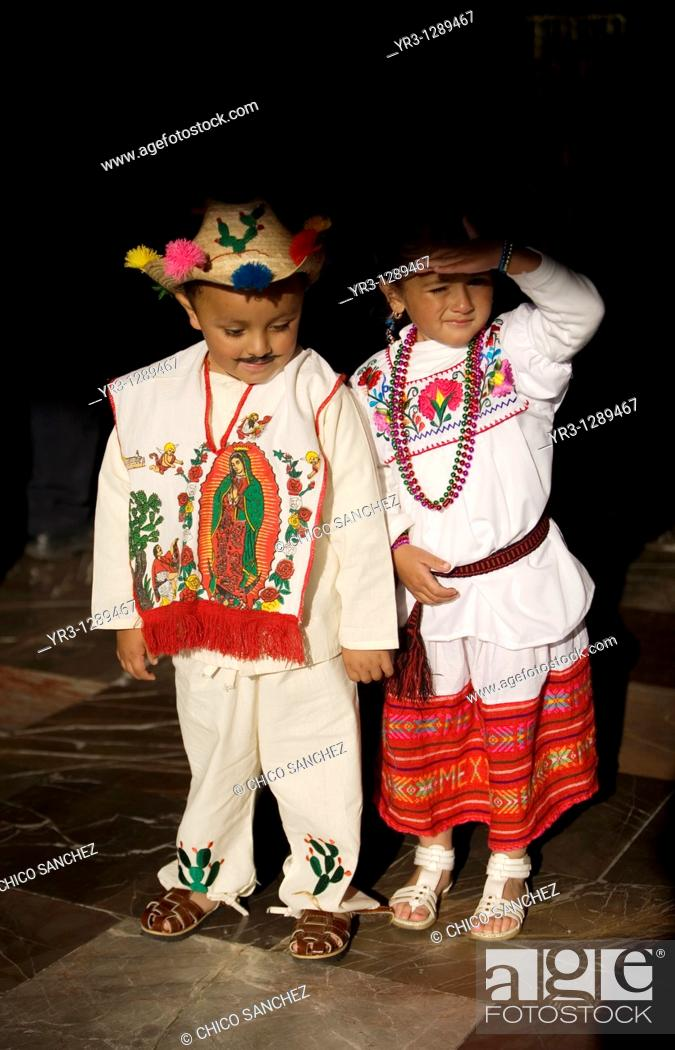Stock Photo: Children dressing traditional indigenous costumes pose in the Our Lady of Guadalupe Basilica in Mexico City, December 8, 2010  Hundreds of thousands of Mexican.