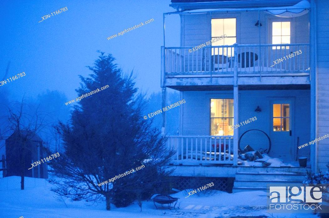 Stock Photo: House in snow at night.