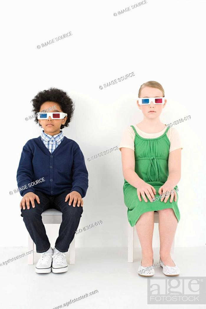 Stock Photo: Boy and girl in 3D glasses.