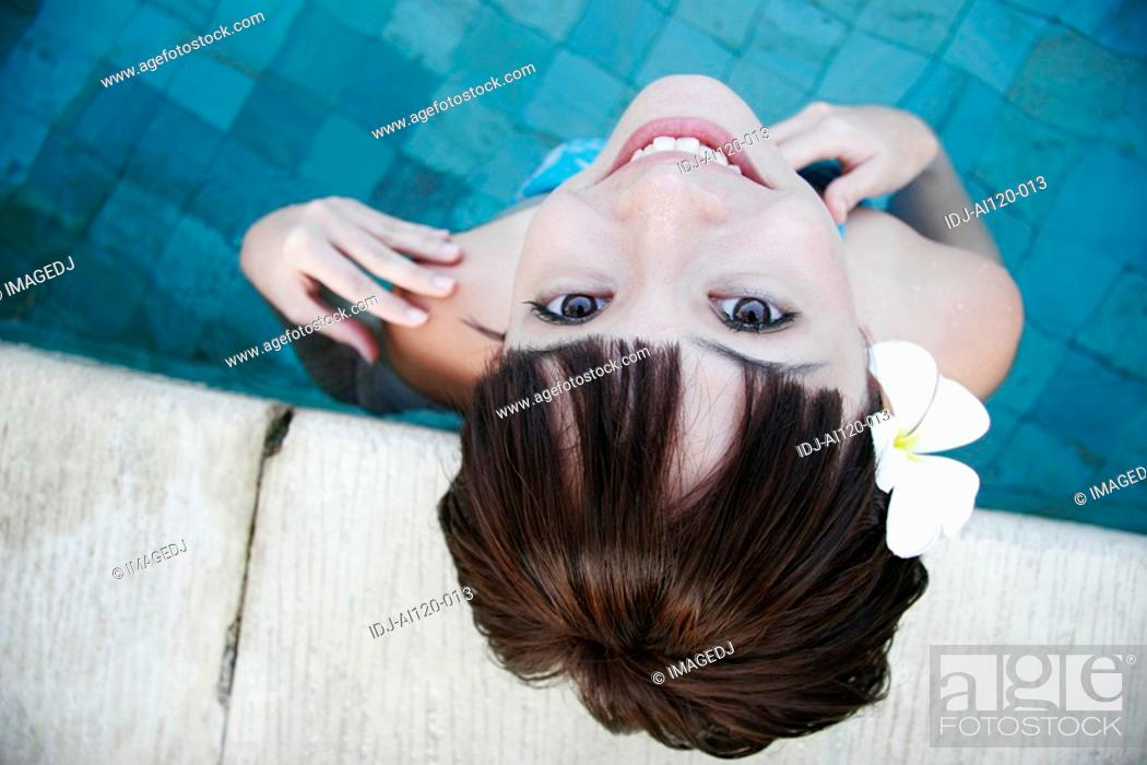 Stock Photo: Portrait of a teenage girl standing in swimming pool.