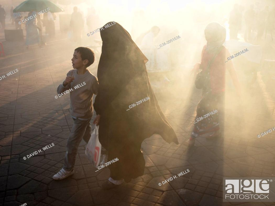 Stock Photo: Smoke shrouded marketplace in Djemaa el-Fna square, (the main square) in the Medina in Marrakesch, Morrocco.