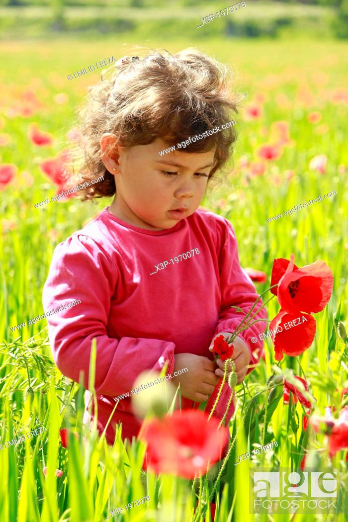 Stock Photo: Little girl with flowers.