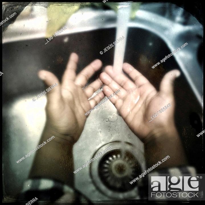 Stock Photo: Child washing hands.