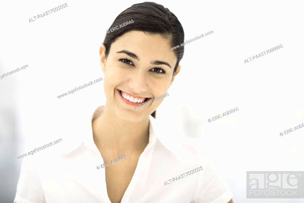 Stock Photo: Woman smiling at camera, portrait.