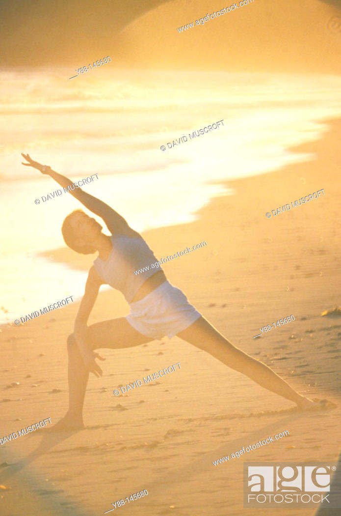 Stock Photo: Woman stretching on the beach.
