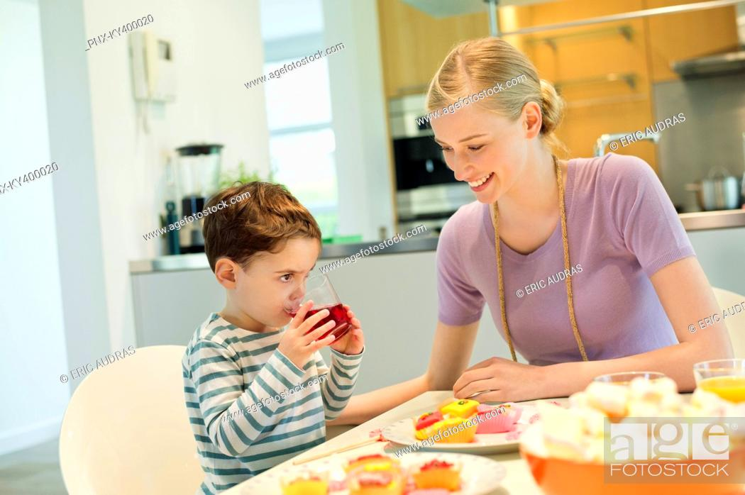 Stock Photo: Woman and son at breakfast table.