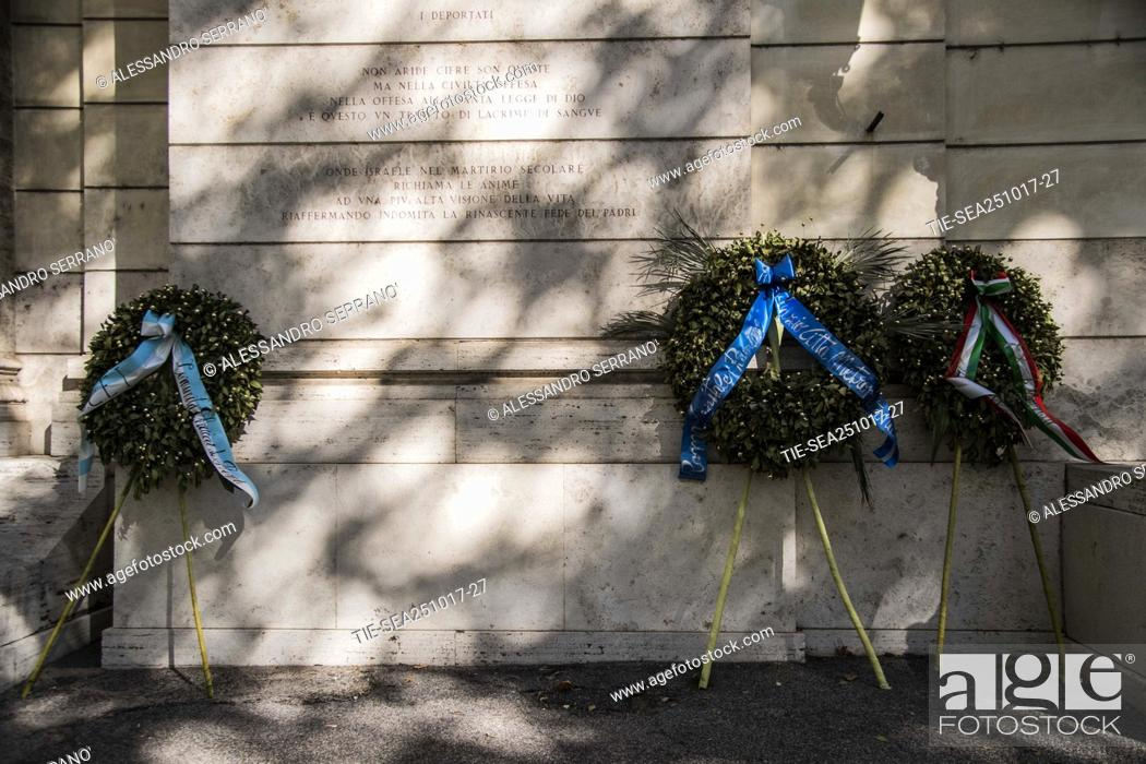 Stock Photo: The crown of white and blue flowers deposited by the Lazio president Lotito in front of the synagogue of Rome was thrown into the Tiber river.