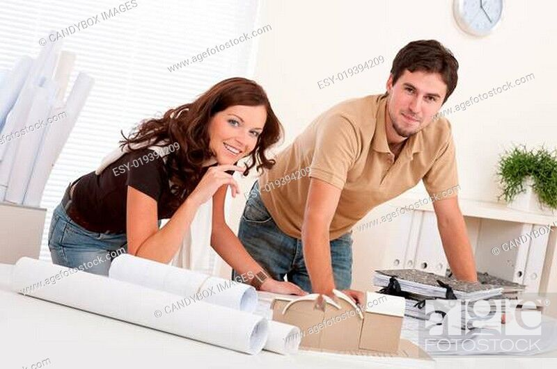 Stock Photo: Young man and woman working at architect office.