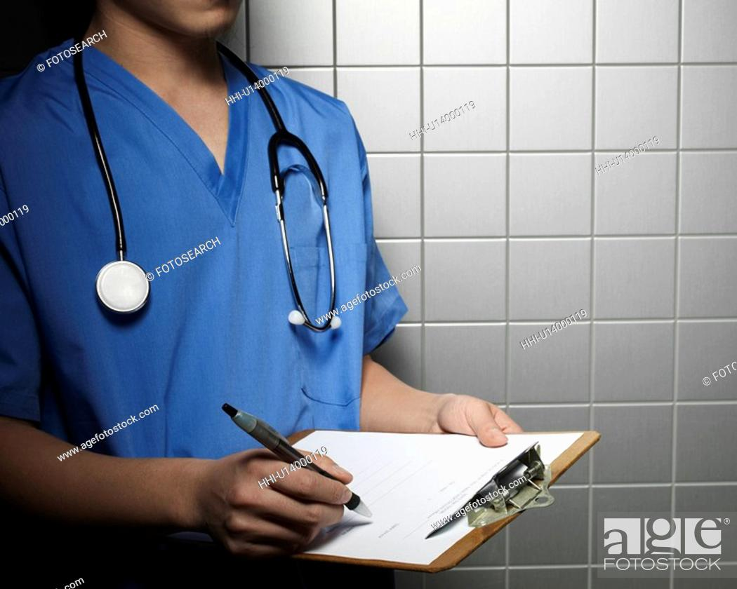 Stock Photo: Doctor Making Notes.
