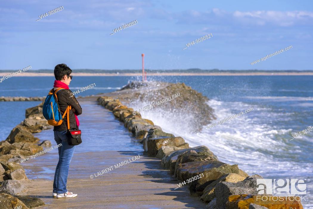 Stock Photo: Woman Watching Waves on the Jetty at Jard-sur-Mer Harbor, Sables-d'Olonne District, Vendée Department, Pays de la Loire Region, France, Europe.