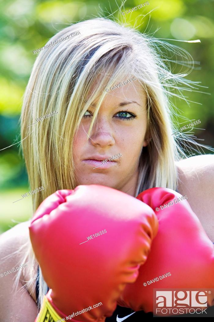 Stock Photo: Teenage girl in boxing gloves.