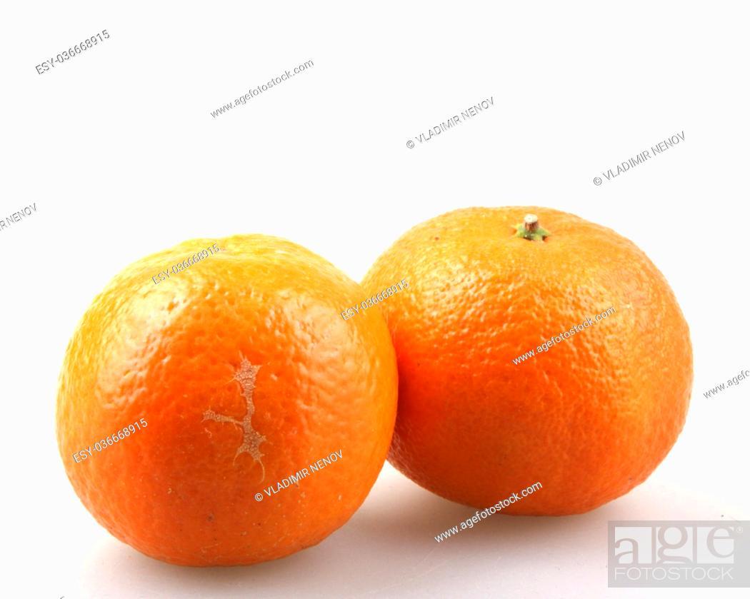 Stock Photo: Fresh tangerine fruits on a white background.