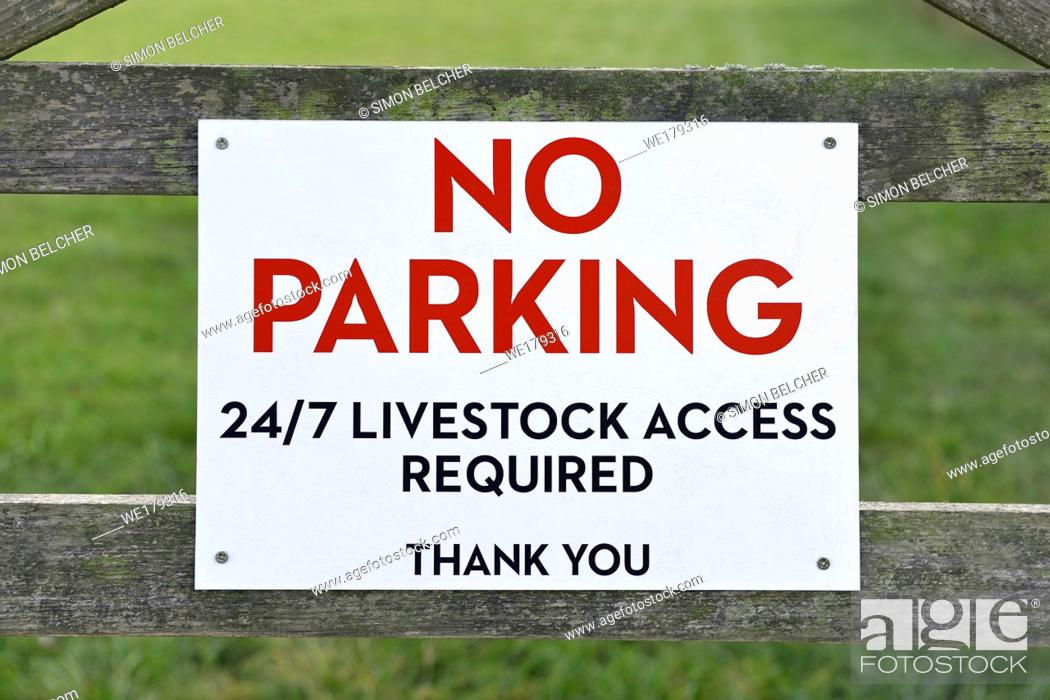 Stock Photo: No Parking, Livestock Access Required, Sign on a gate to a field, Oxfordshire, England, United Kingdom.