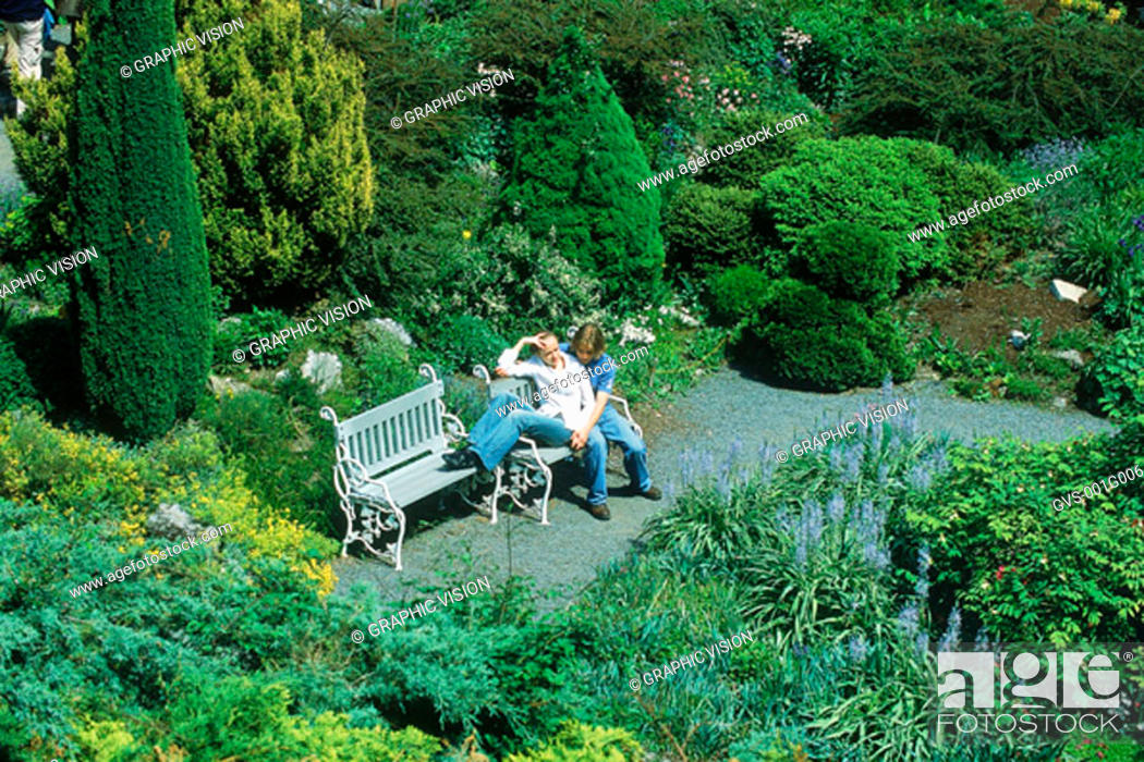 Stock Photo: Young couple sitting on a park bench.