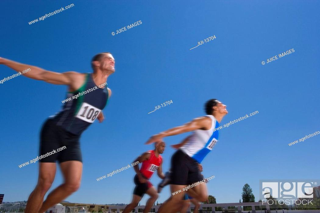 Stock Photo: Male sprinters on track, low angle view.