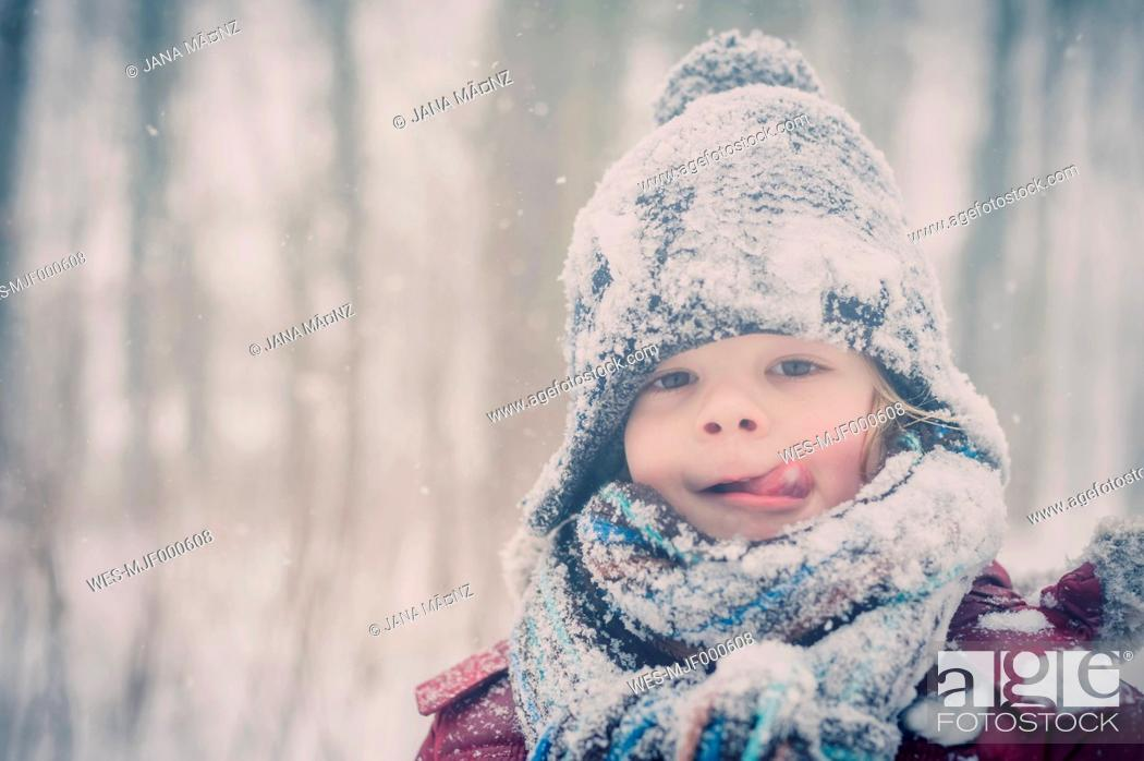 Stock Photo: Boy in snow, portrait.