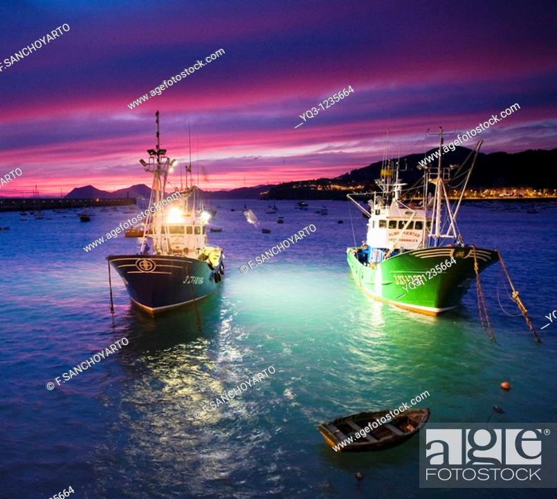 Stock Photo: Fishing boats at dawn. Port of Castro Urdiales, Cantabria, Spain.