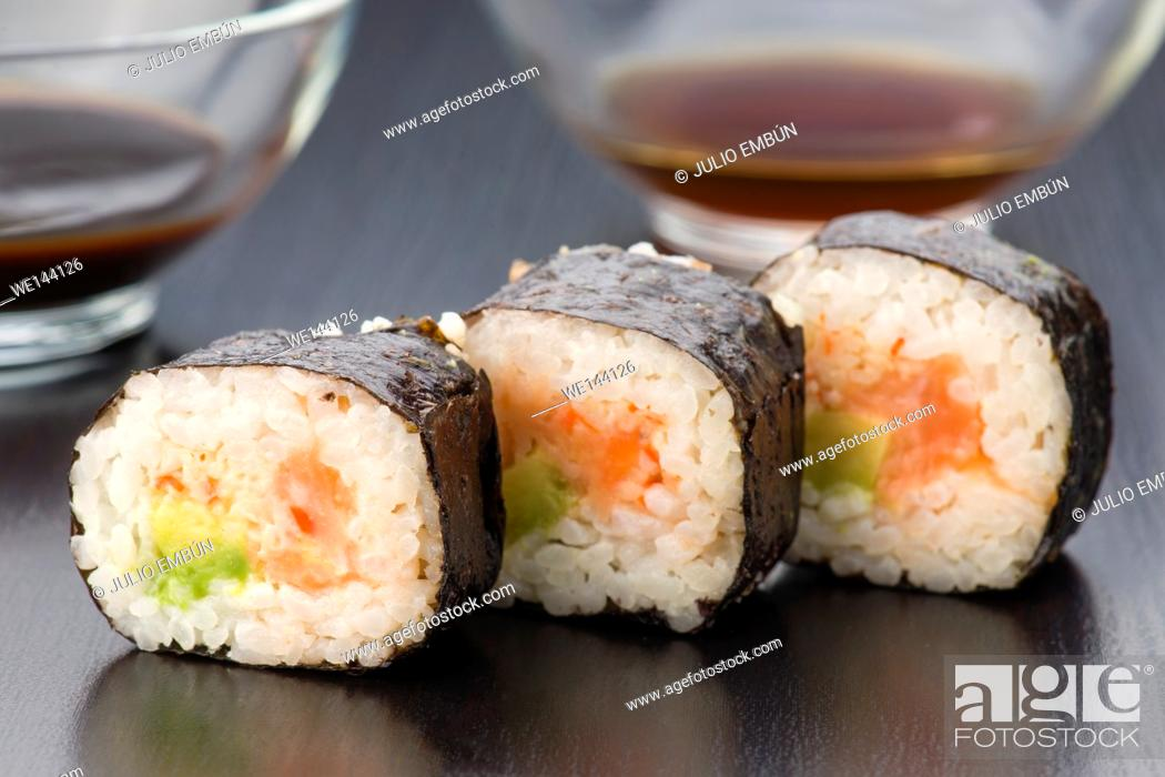 Photo de stock: Japanese sushi in classic dark wood base.