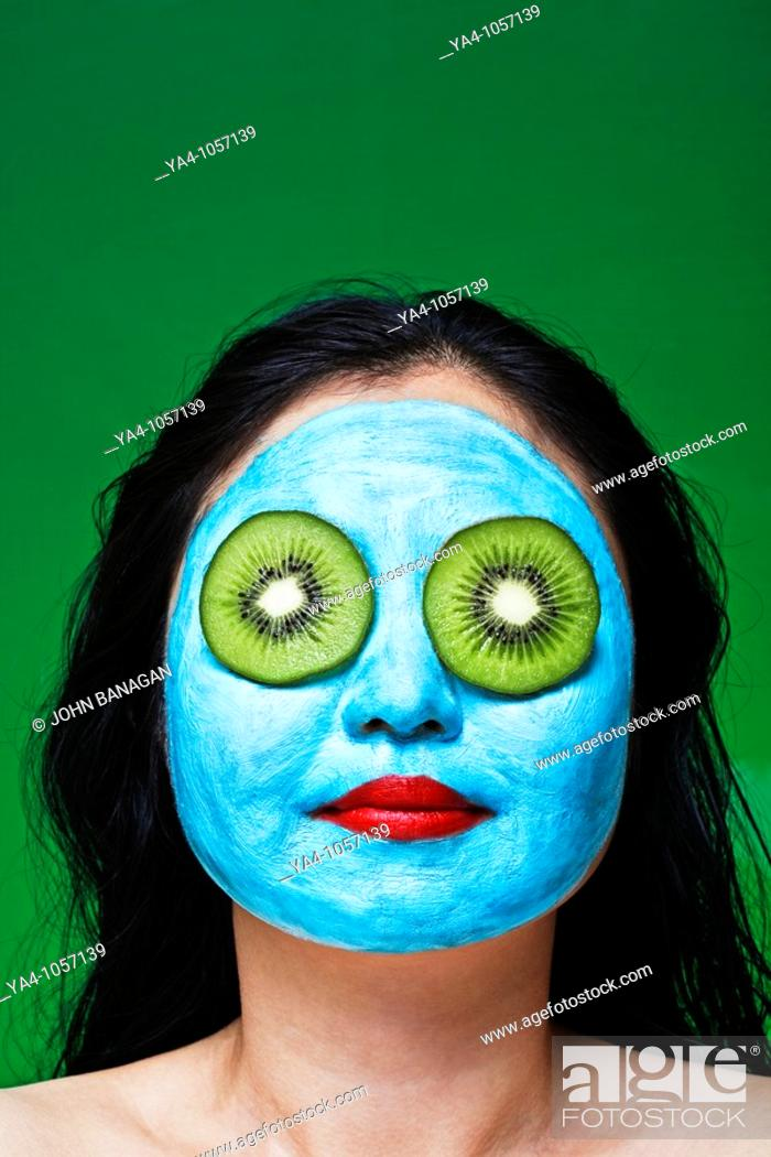Stock Photo: Chinese woman with facial mask.