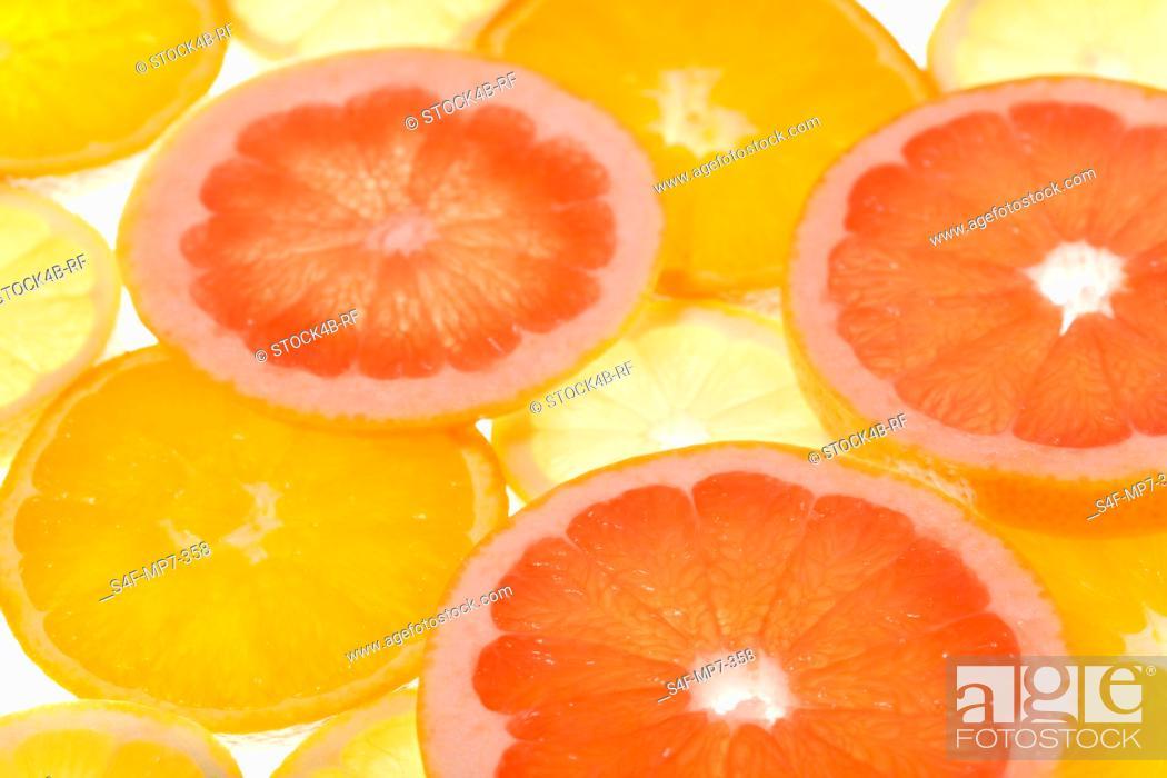 Stock Photo: Detail of orange, grapfruit and lemon slices.