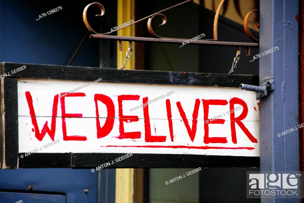 Stock Photo: New York City, we deliver sign , manhattan.