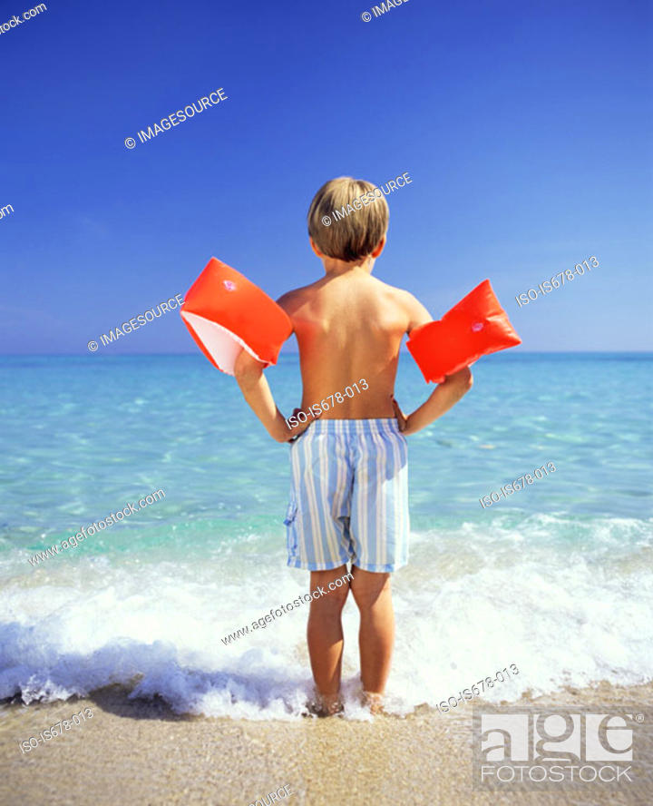Stock Photo: Boy paddling with arm bands.