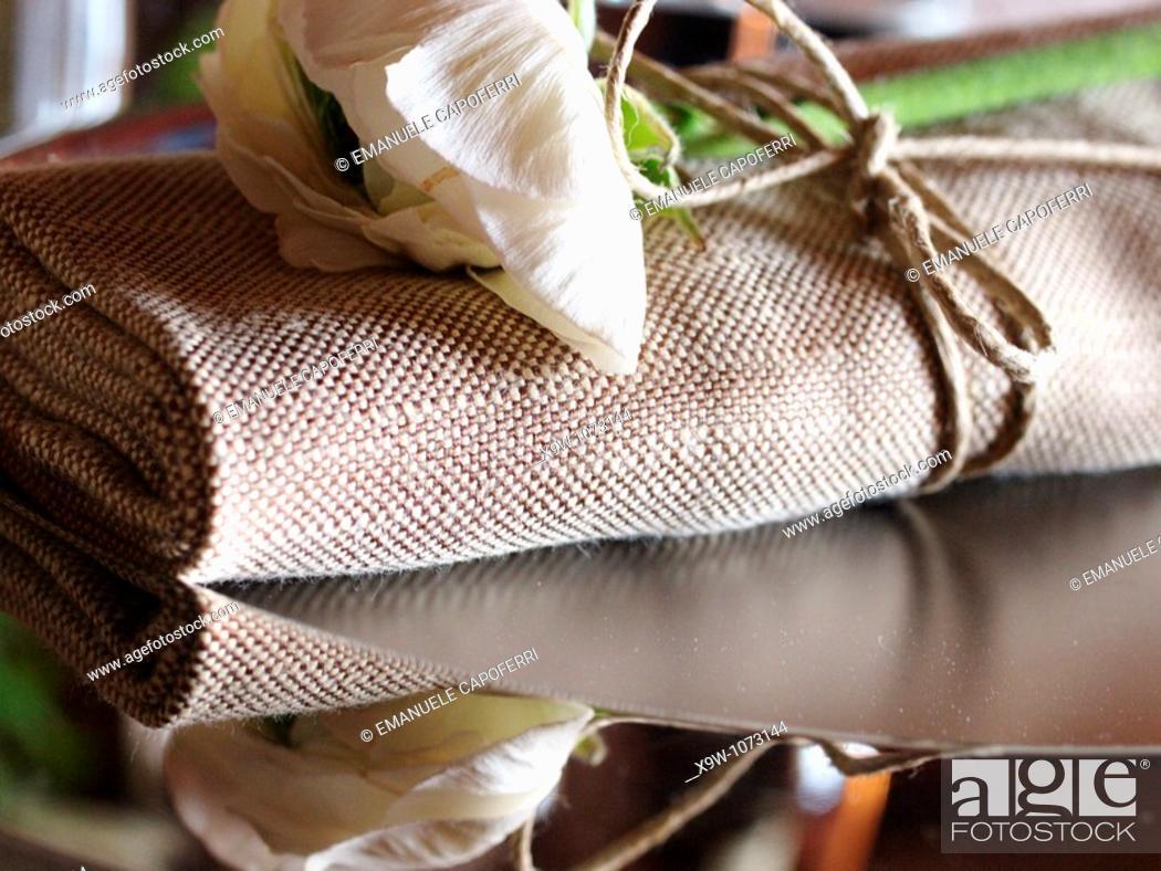 Stock Photo: flower and napkin.