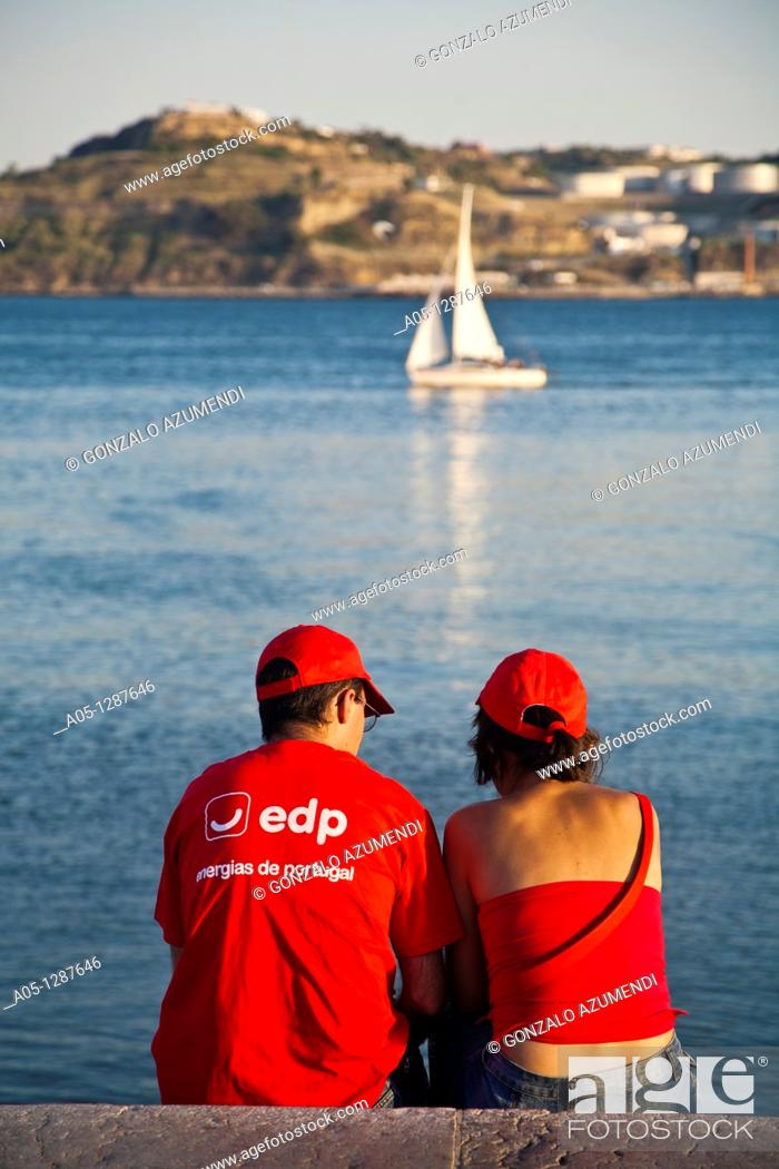 Stock Photo: Couple looking the sea. Lisbon, Portugal.