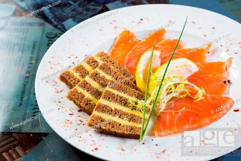 Stock Photo: Salmon snack on the white plate.