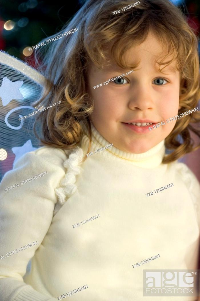 Stock Photo: girl in angel costume.