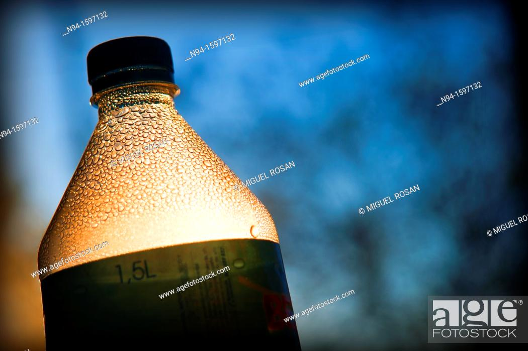 Stock Photo: Top of a bottle to the light, bottled mineral water.