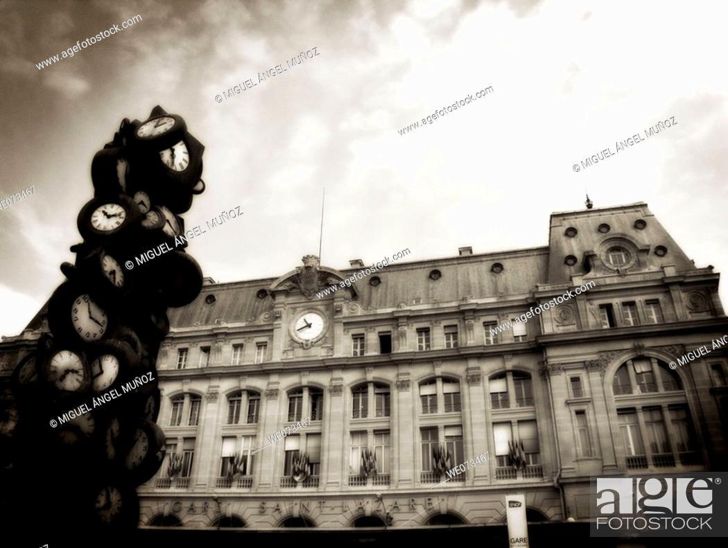 Stock Photo: L'heure de tous (1985), sculpture by Arman (Armand Pierre Fernandez, 1928-2005), Gare Saint-Lazare (Saint Lazare railway station), Paris.
