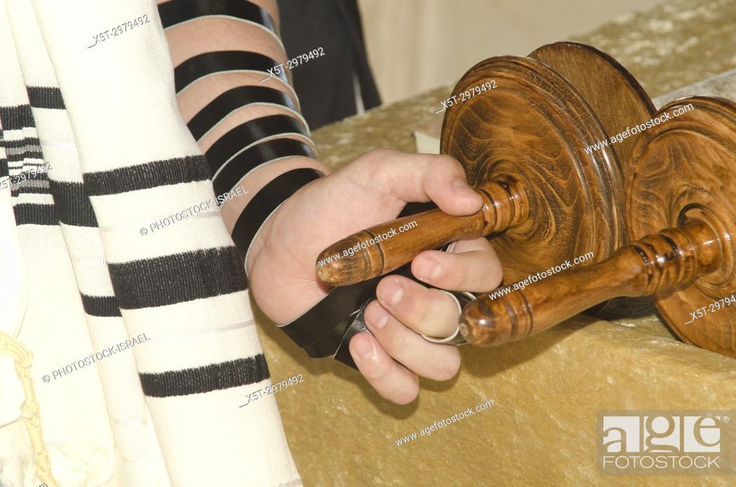 Stock Photo: Bar Mitzvah ceremony. Bar Mitzvah boy the Torah scrolls.