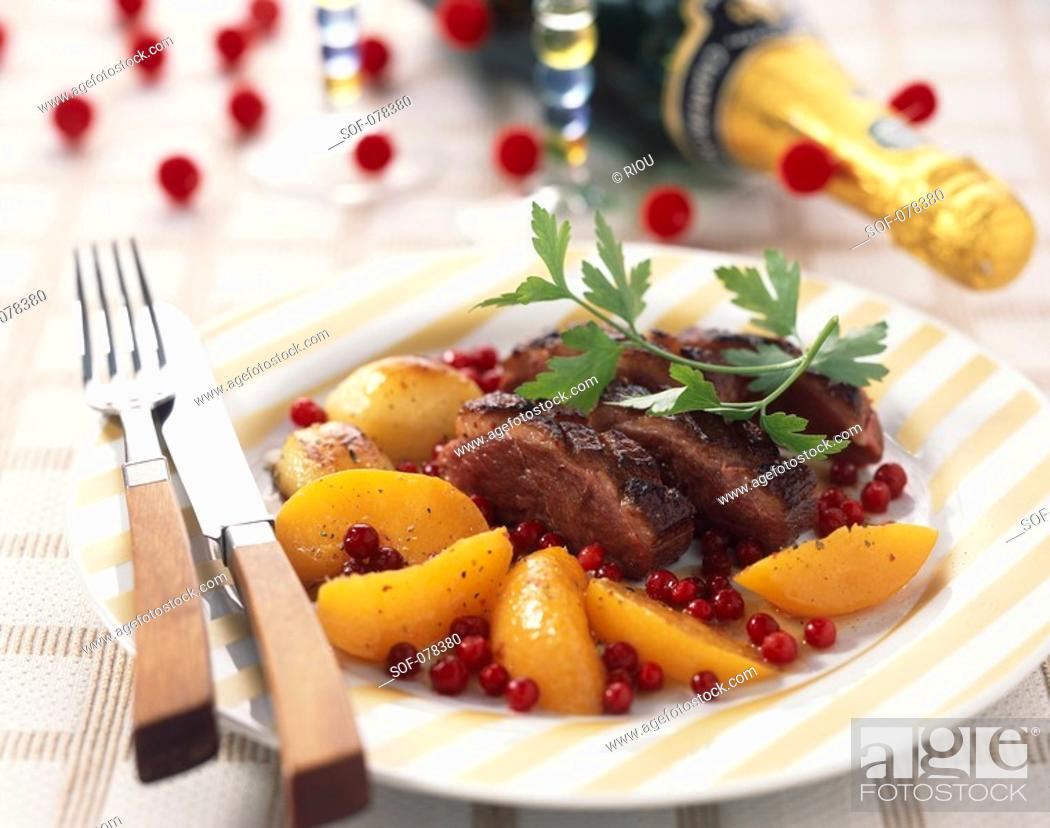 Stock Photo: Duck fillet with peaches.