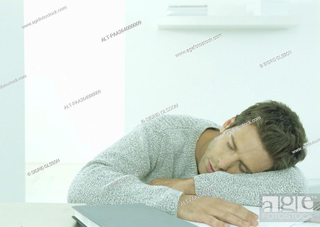 Stock Photo: Man sleeping at table.